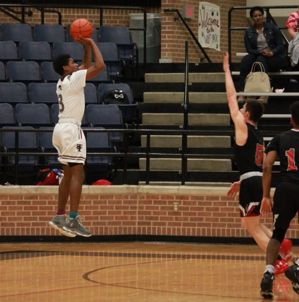 In the beginning of the season, Junior Desmond Clark choose to be number 3 for our Varsity Boys Basketball team.