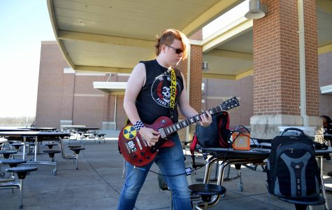 Freshman Shares Guitar Skills During, After School