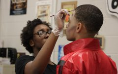 Theater students help student council with the makeup for the Senior Prep Rally.