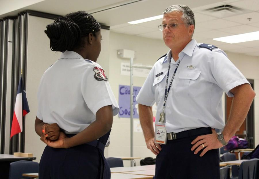 During uniform inspection, Meta Tshiteya, talks to Colonel Webster about her future job in public affairs.