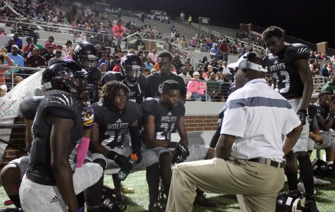 Varsity Loses Against Cross Town Rival