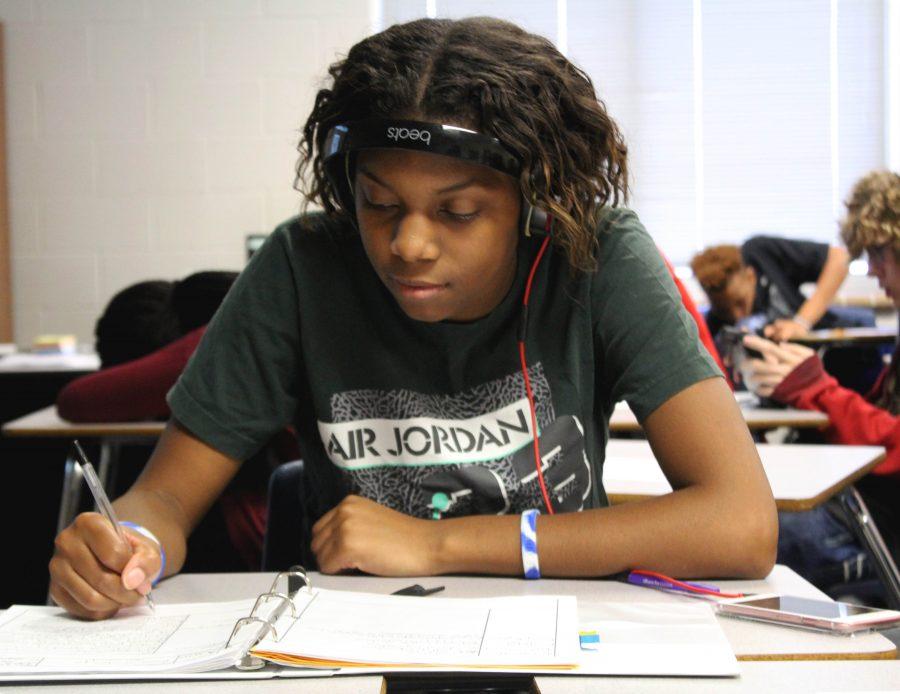 During class, Jaryanna Ward,12, wears her cancer support bracelet.