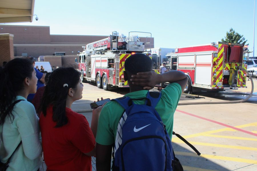 During A Lunch, students were being evacuated from the school. Junior, Omar Juma was waiting in line to get his food.