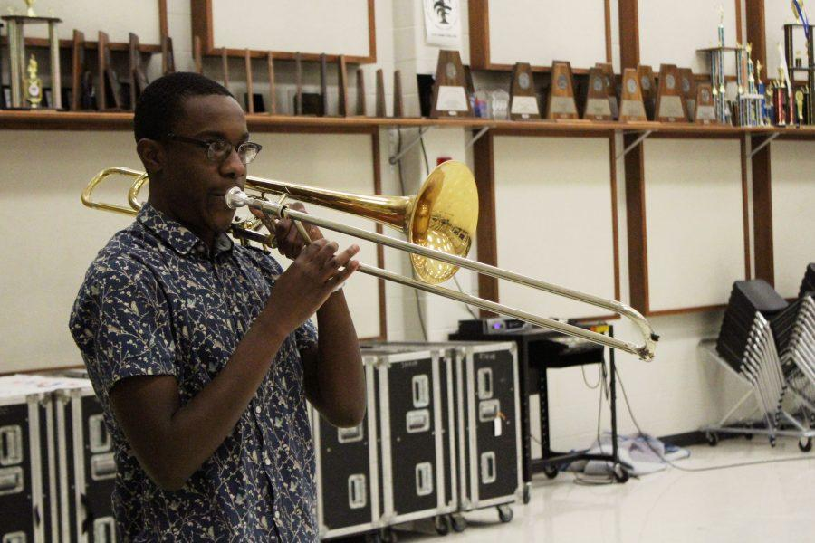 Five days a week, senior Moses Eboh practices his Trombone. This is Eboh's first year making it into All-State.