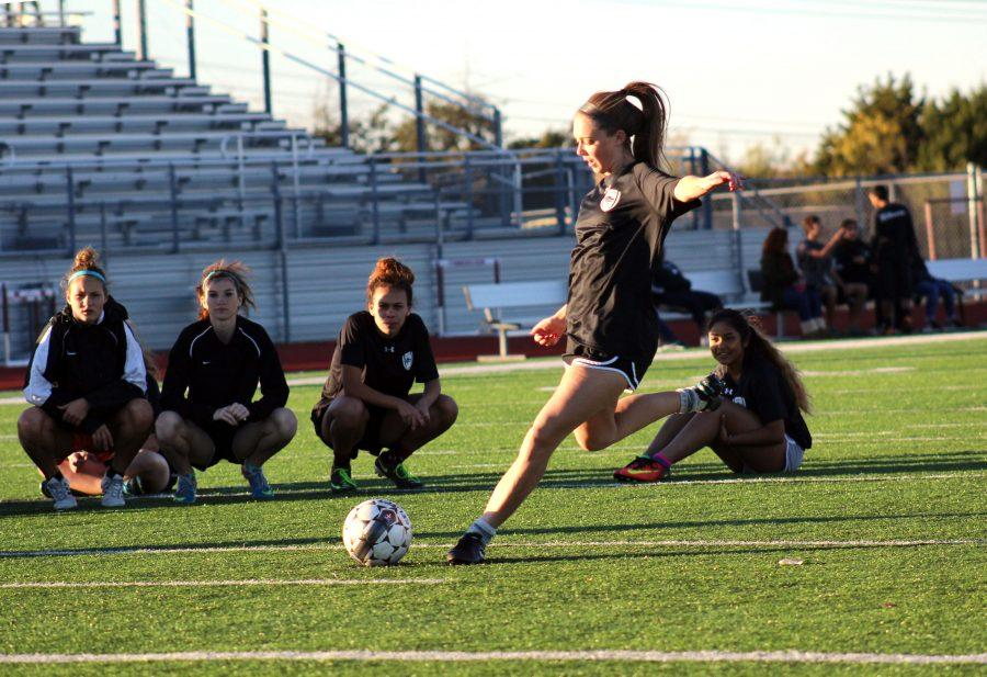 During practice, senior Blake Aldridge practice penalty kicks. Aldridge is one of the captains for our varsity girls soccer team.