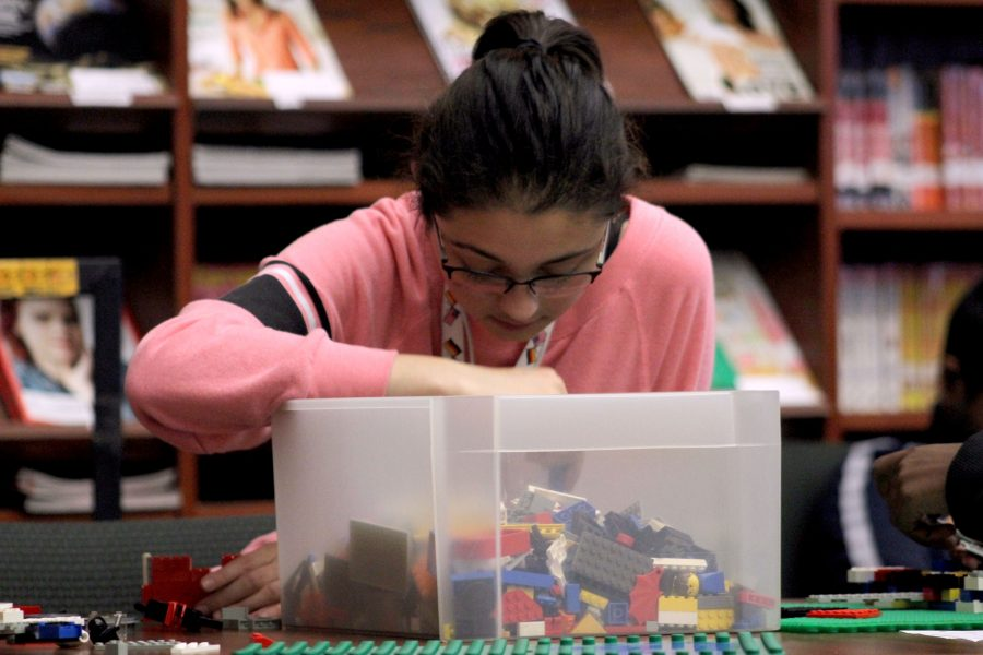 During Lunch, Janeen Abdellatif (10) plays legos in the library.