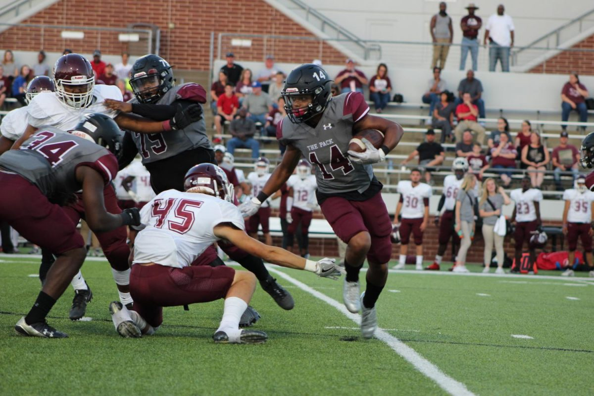 Varsity Football Wins First District Game