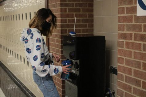 Junior Kaitlyn Salee refills her water bottle.