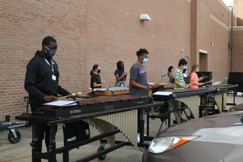 The band practices during sixth block outside, near the band hall.